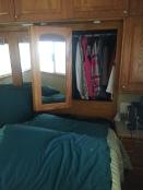 Mirrored closet doors open